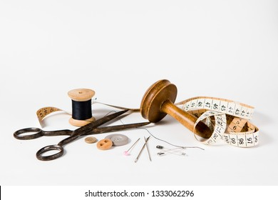 Tailor still life set - vintage tools for handmade custom tailoring industry. On white background.
