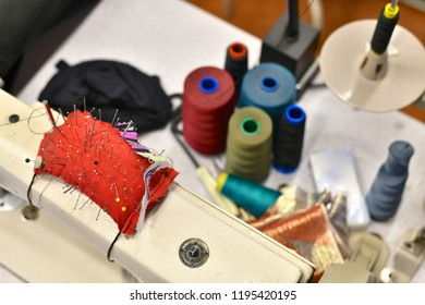 Tailor utensils - pins and colored thread