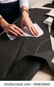 Tailor at work. Close-up of woman's hand