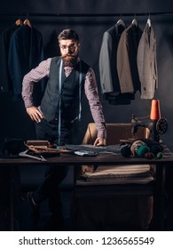 Tailor at work. retro and modern tailoring workshop. sewing mechanization. business dress code. Handmade. Bearded man tailor sewing jacket. suit store and fashion showroom. Talented tailor.
