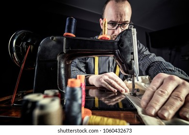 tailor at work with vintage sewing machine