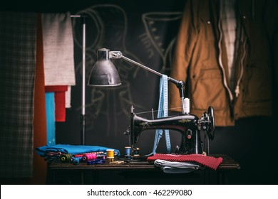 Tailor workshop with old sewing machine and cloth