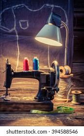 Tailor workshop with sewing machine and cloth