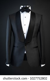 Tailored suit, tuxedo isolated on black background on mannequin