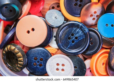 Tailoring accessories, group of colorful buttons piled on a group