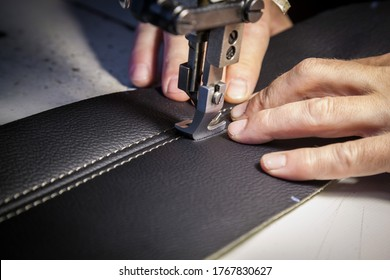 Tailoring of leather products. Repair of the car seat cover. - Shutterstock ID 1767830627