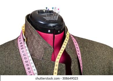 tailoring of man tweed jacket on dummy isolated on white background