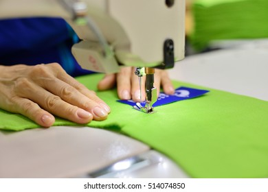 Tailoring Process - Women's hands behind her sewing