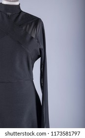 A Tailors Mannequin dressed in a Black Dress with Mesh Arms