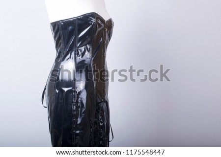 tailors mannequin dressed black pvc corset stock photo