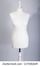 A Tailors Mannequin on a grey background