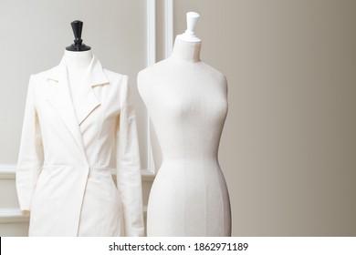 Tailor's textile mannequin in clothes designer show room