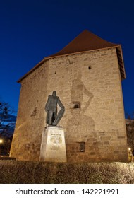 Tailors' Tower and Baba Novac Monument, Cluj, Romania -  best conserved piece of Cluj-Napoca's 17th century ramparts, as seen at the blue hour.