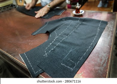 A tailor's work table with  cloth for a jacket cut and marked up for sewing. (SELECTIVE FOCUS)