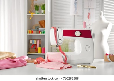 Tailor's workplace with modern sewing machine