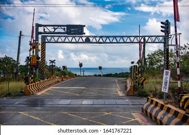 Taimali, Taiwan - December 20 2019: The railway crossing with ocean as backdrop which is similar to the scene in a cartoon Slum Dunk. It becomes a famous tourist spots for photo.