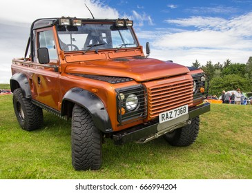 TAIN, SCOTLAND - JUNE 18 2017: Land Rover Defender parked on grass