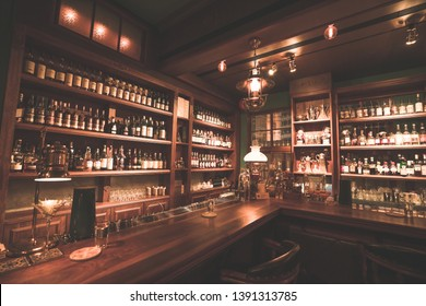 """Tainan City, Taiwan - April 19th, 2019: The interior of Bar named """"Bar Home"""", one of good bars in Tainan City, Taiwan. People are talking and drinking wine or drinks in this bar."""
