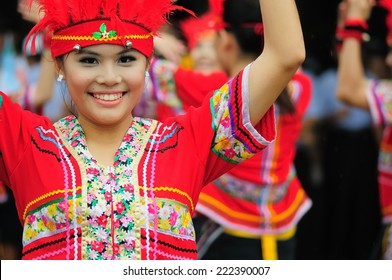 Tainan, Taiwan - July 16 : Beautiful native girls, Kwan-Yin Buddha Christmas is celebrated, performed aboriginal dances before the Chao Feng Temple on July 16 ,2011 in Tainan, TAIWAN