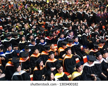 TAINAN, TAIWAN -- JUNE 2, 2018: Graduates listen to a speech at the annual graduation ceremony of NCKU university.