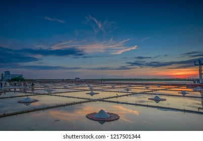 Tainan , Taiwan - Sep 22, 2018: The sunset of Salt pans,Tile-Paved Salt Fields,salt mountain, in Jingzaijiao, the oldest pancake salt pan field in Taiwan