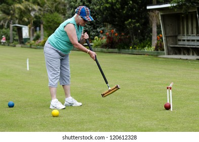 TAIPA - NOV 28:Croquet player play in Taipa club in Taipa, New Zealand on November 28, 2012.It's the first outdoor sport to embrace equality, allowing both sexes to play the game on an equal footing.