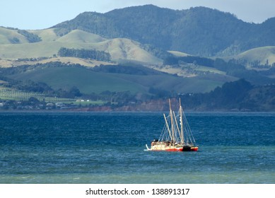TAIPA,NZ -MAY 18:Two traditional double-hulled waka and their crews have arrived in Doubtless Bay in Northland New Zealand on May 18 2013. After a 10-month historic voyage across the pacific Ocean.