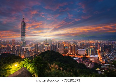 The Taipei 101 towers over the Xinyi District at twilight