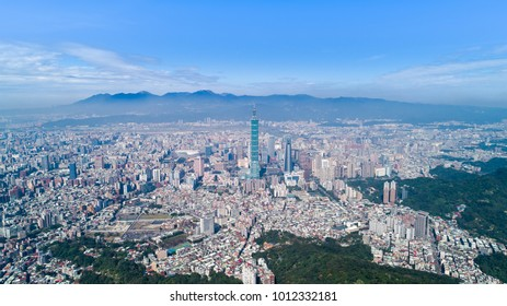 Taipei City Aerial View - Asia business concept image, panoramic modern cityscape building bird's eye view in morning blue bright sky. Drone photography shot in Taipei, Taiwan.