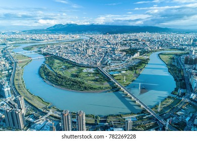 Taipei City Aerial View - Asia business concept image, panoramic modern cityscape building bird's eye view under sunrise and morning blue bright sky, shot in Taipei, Taiwan.