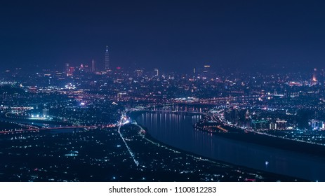 Taipei City Skyline Aerial View - Asia business city concept image, modern cityscape building birds eye night view use the drone in New Taipei, Taiwan.