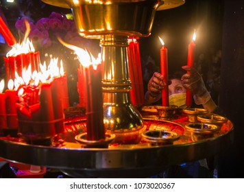 TAIPEI - FEB 18 : Taiwanese woman lights a candle during Chinese new year in Longshan temple in Taipei Taiwan on February 18 2018. The temple was built in 1738