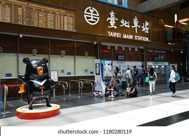 Taipei main train station, Taipei, Taiwan. 2017 06 12.  Most people choose to sit down on black part, not white for some reason.