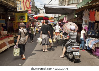 TAIPEI MAY 16: People walk and shop on a street open market in Taipei, Taiwan on May 16, 2014. People still love to come to traditional markets for the fresh food