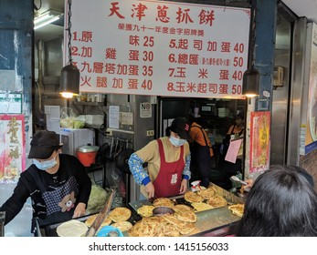 Taipei: Taiwan, 01 04 2019: ShiDa Night market assorted deep fried food stall with customers.