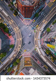 Taipei, Taiwan - 06/26/2019 : Aerial view of cars and trains with intersection or junction with traffic, Taipei Downtown, Taiwan. Financial district and business area. Smart urban city technology.
