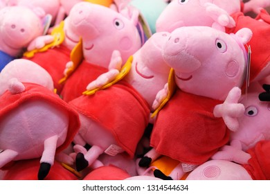 Taipei, Taiwan - 16 Feb, 2019 : Peppa pig dolls sold in coin operating machine by using clamp to pull the toy up.