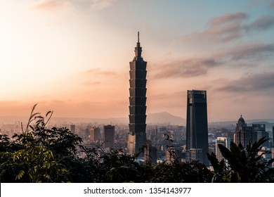 Taipei, Taiwan - 3/2/19 - Sunset over Taipei skyline.  Taipei 101 skyscraper featured.