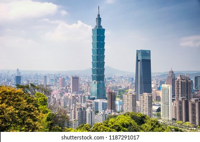 Taipei, Taiwan.   April 1, 2018.   The Taipei 101 landmark building rising above generic architecture in the city of Taipei Taiwan on a sunny day as seen from Xiangshan or Elephant Mountain.