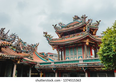 Taipei, Taiwan - April 12, 2019: Fly eaves roof (Chinese style) at Longshan Temple in Wanhua district of Taipei, Taiwan. One of the most popular tourist destination