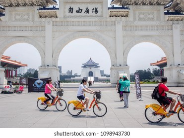 Taipei, Taiwan - April 22,2018. Tourist using YouBike to Touring and Exploration over the Liberty Square and National Chiang Kai-shek Memorial Hall. YouBike is the Bike Sharing System in New Taipei