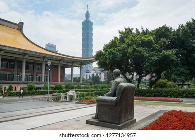 Taipei, Taiwan - April 25, 2018 : Statue of Sun Yat-sen at the National Sun Yat-sen Memorial Hall, with view of Taipei 101 building in background.