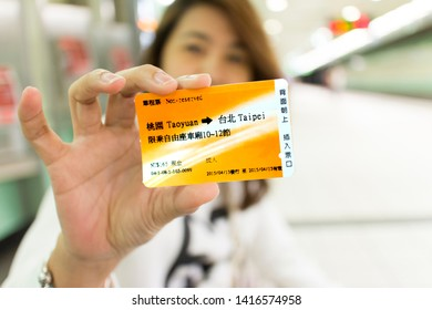 TAIPEI TAIWAN - APRIL 27, 2015: Asian woman show  Taiwan High Speed Rail (THSR) ticket in hand. enjoy fast and convenient transport, travels anywhere around the country easily.