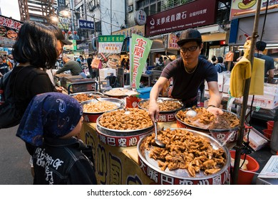 Taipei, Taiwan - April 4, 2017: Raohe Street Night Market, Taipei, Taiwan.It is one of the oldest night markets in Songshan District, Taipei, Taiwan.