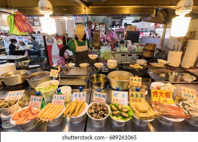 Taipei, Taiwan - April 6, 2017: Food stall at the The Shilin Night Market in Taipei, Taiwan. Shilin  Night Market is a night market in the Shilin District of Taipei, Taiwan.