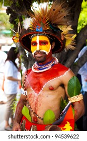 Taipei, Taiwan - August 24, 2011: A Papua New Guinea tribesman in traditional tribal colors and decoration for a performance at Taiwan's centennial celebration