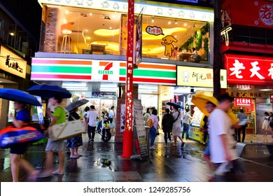 TAIPEI, TAIWAN - August 29, 2018: 7-Eleven shop at night in the Ximending Pedestrian Area in Taipei, Taiwan. 7-Eleven is an international chain of convenience stores.