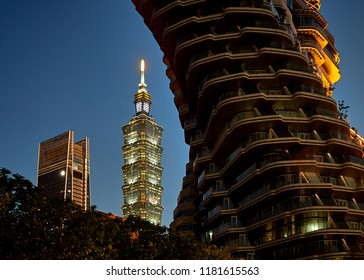 Taipei, Taiwan  - August 30 2018: Evening view over building construction in the downtown, close up look at famous skyscrapers and eco-friendly house. Smart city concept