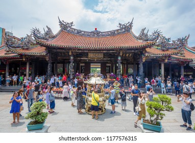 Taipei, Taiwan - August 5th, 2018: People at the Longshan temple in Taipei