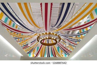 Taipei, Taiwan - Dec 2018: Decorate ceiling with stripe printing fabric and light bulb in ATT 4 Recharge.